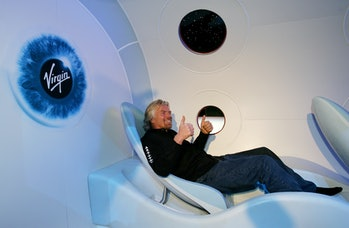 Sir Richard Branson gives a thumbs up from a seat during the unveiling of a scale model of Virgin Ga...