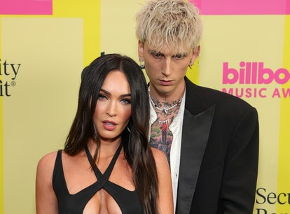 LOS ANGELES, CALIFORNIA - MAY 23: Machine Gun Kelly and Meghan Fox poses backstage for the 2021 Bill...