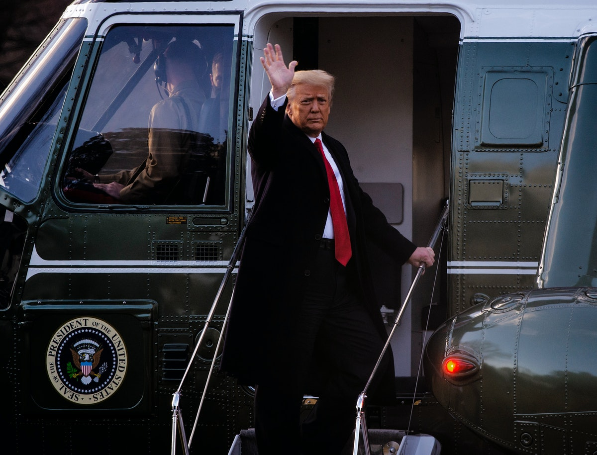 President Donald Trump gives a final wave as he boards Marine One as he and First Lady Melania Trump depart the White House for the last time in Washington, DC.