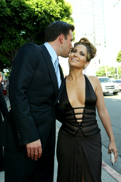 """WESTWOOD, CA - JULY 27:  Actors Ben Affleck and Jennifer Lopez attend the premiere of Revolution Studios' and Columbia Pictures' film """"Gigli"""" at the Mann National Theatre July 27, 2003 in Westwood, California.  """"Gigli"""" opens nationwide on August 1, 2003.  (Photo by Kevin Winter/Getty Images)"""