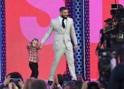 LOS ANGELES, CALIFORNIA - MAY 23: (L-R) Adonis Graham and Drake, winner of the Artist of the Decade Award, speak onstage for the 2021 Billboard Music Awards, broadcast on May 23, 2021 at Microsoft Theater in Los Angeles, California. (Photo by Kevin Mazur/Getty Images)
