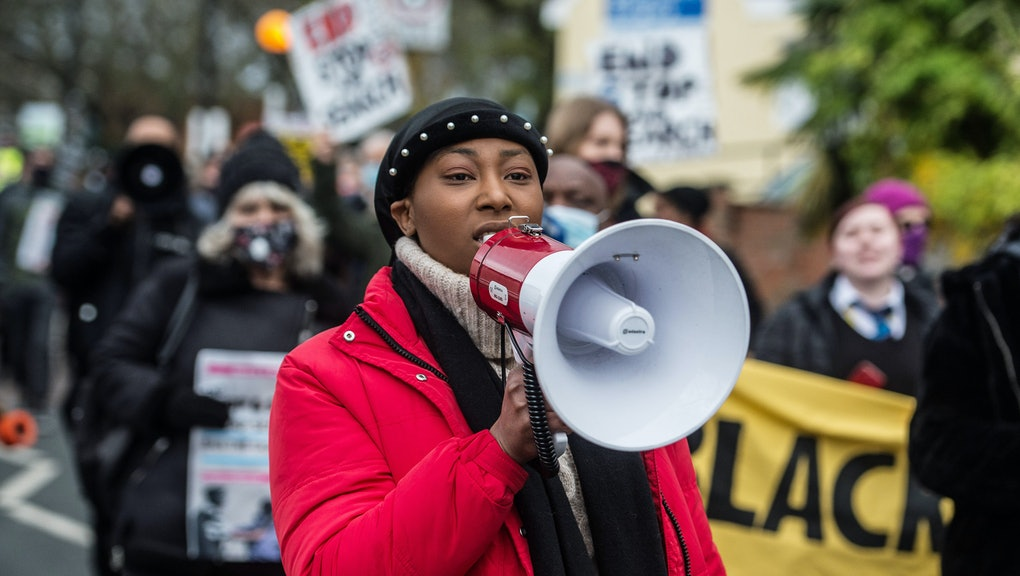 LONDON, ENGLAND - DECEMBER 11:  Black Lives Matter activist Sasha Johnson joins anti-racists, community activists and school children at a protest against police violence as they march from Park View School to Tottenham Police Station, after a video of a policeman appearing to strike a black teenager in the head outside the school went viral on twitter, on December 11, 2020 in London, England. (Photo by Guy Smallman/Getty Images)