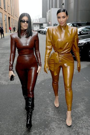 PARIS, FRANCE - MARCH 01: (EDITORIAL USE ONLY) Kourtney and Kim Kardashian attend the Balenciaga sho...