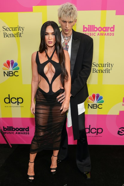LOS ANGELES, CALIFORNIA - MAY 23: Meghan Fox and Machine Gun Kelly poses backstage for the 2021 Bill...