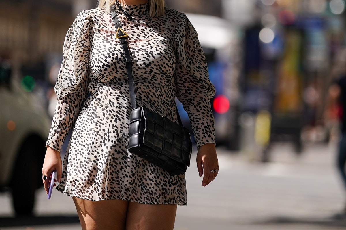PARIS, FRANCE - JULY 09: A passerby wears a leopard print turtleneck short dress, a black woven leather Bottega Veneta bag, on July 09, 2020 in Paris, France. (Photo by Edward Berthelot/Getty Images)