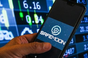 SafeMoon logo trading on smartphone