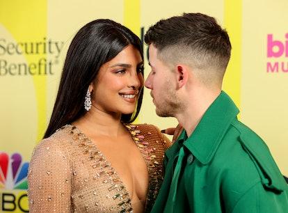 Nick Jonas and Priyanka Chopra shared a sweet kiss on the 2021 BBMAs red carpet.