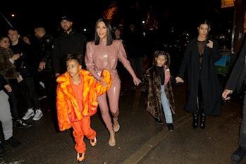PARIS, FRANCE - MARCH 01: Kim Kardashian, North West ,Penelope Disick and Kourtney Kardashian are se...