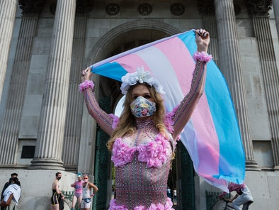 A woman supports trans rights during Pride Month.