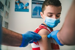 Patient Getting Vaccinated against COVID-19. Child, teenage boy vaccination. Coronavirus epidemic. C...