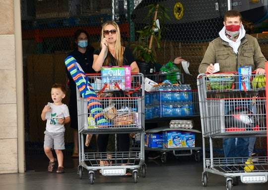 Huntington Beach, CA - May 17: Masked and unmasked shoppers leave Costco at Bella Terra in Huntingto...