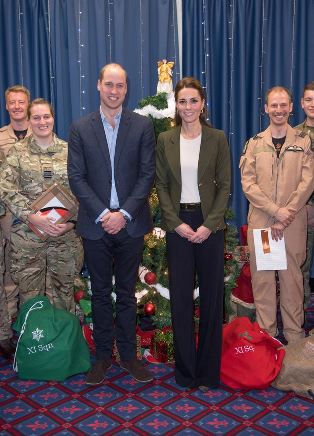 Prince William says his wife was camouflaged by a Christmas tree.