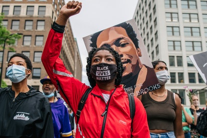 MINNEAPOLIS, MINNESOTA - MAY 23: People march during an inaugural remembrance demonstration for Geor...