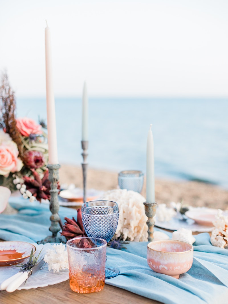 Tablescape for a beach wedding in Santorini with coral and blue details