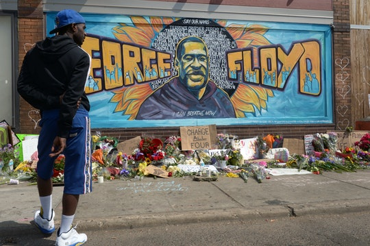 """MINNEAPOLIS, MINNESOTA -- """"I am lost for words, I am baffled, I am hurt, I can't fathom what his family is going through. This is hate,"""" says Dale Zarlee, 35, as he stands in front of the George Floyd mural  at the intersection of 38th Street and Chicago Avenue in South Minneapolis, in front of the CUP Foods where George Floyd died earlier in the week, Saturday, May 30 2020. (Scott Takushi / MediaNews Group / St. Paul Pioneer Press via Getty Images)"""