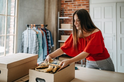 Woman packing item that she sells online