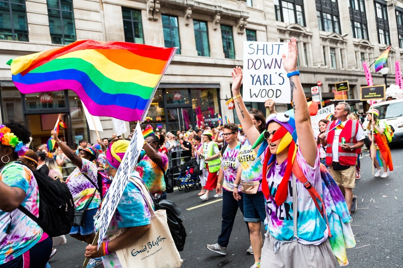 London, UK - 6 July, 2019: color image depicting crowds of people celebrating at the London Gay Pride parade in the city centre. People are dressed in colorful outfits, and the rainbow flag - the symbol of the LGBTQ community - is prevalent. Regent Street is thronged with people at this celebratory event. Room for copy space.