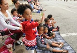 Gizelle Newman, 2, of Pottstown waves to parade participants.Pottstown celebrates the Fourth of July with a parade down High St.  Photo by Jeremy Drey  7/4/2014 (Photo By Jeremy Drey/MediaNews Group/Reading Eagle via Getty Images)