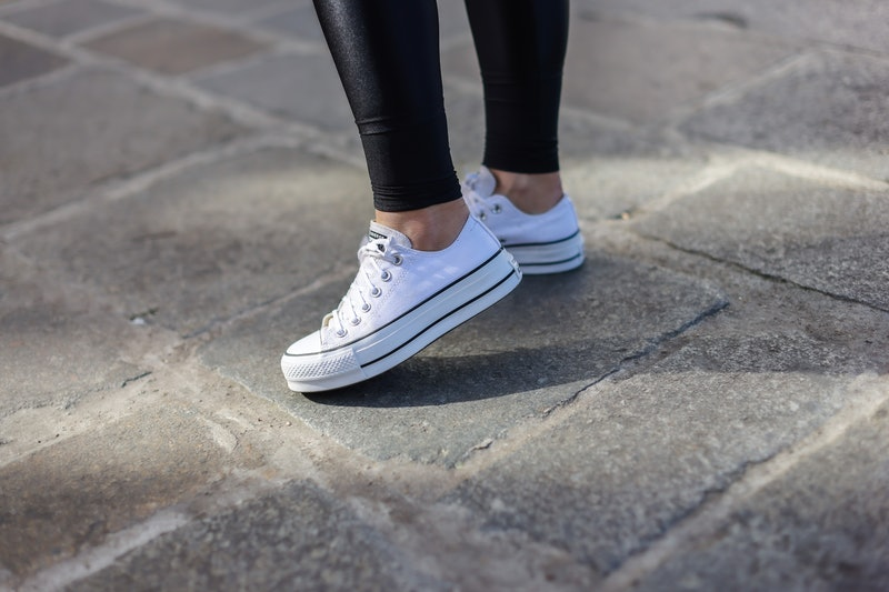 PARIS, FRANCE - APRIL 03: Maria Rosaria Rizzo @lacoquetteitalienne wears black sport leggings, Converse white sneakers shoes, on April 03, 2021 in Paris, France. (Photo by Edward Berthelot/Getty Images)