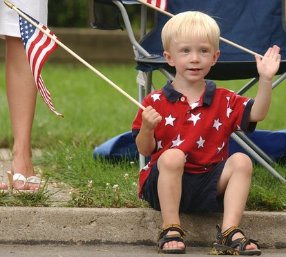 7/4/2006 Photo by Krissy Krummenacker 200601495 Harry T. Hall, III, 2, son of Harry Jr. and Kristen Hall of Oley, waves as the parade passes by during the Wyomissing Centennial parade Tuesday, July 4, 2006, in Wyomissing. (Photo By Krissy Krummenacker/MediaNews Group/Reading Eagle via Getty Images)