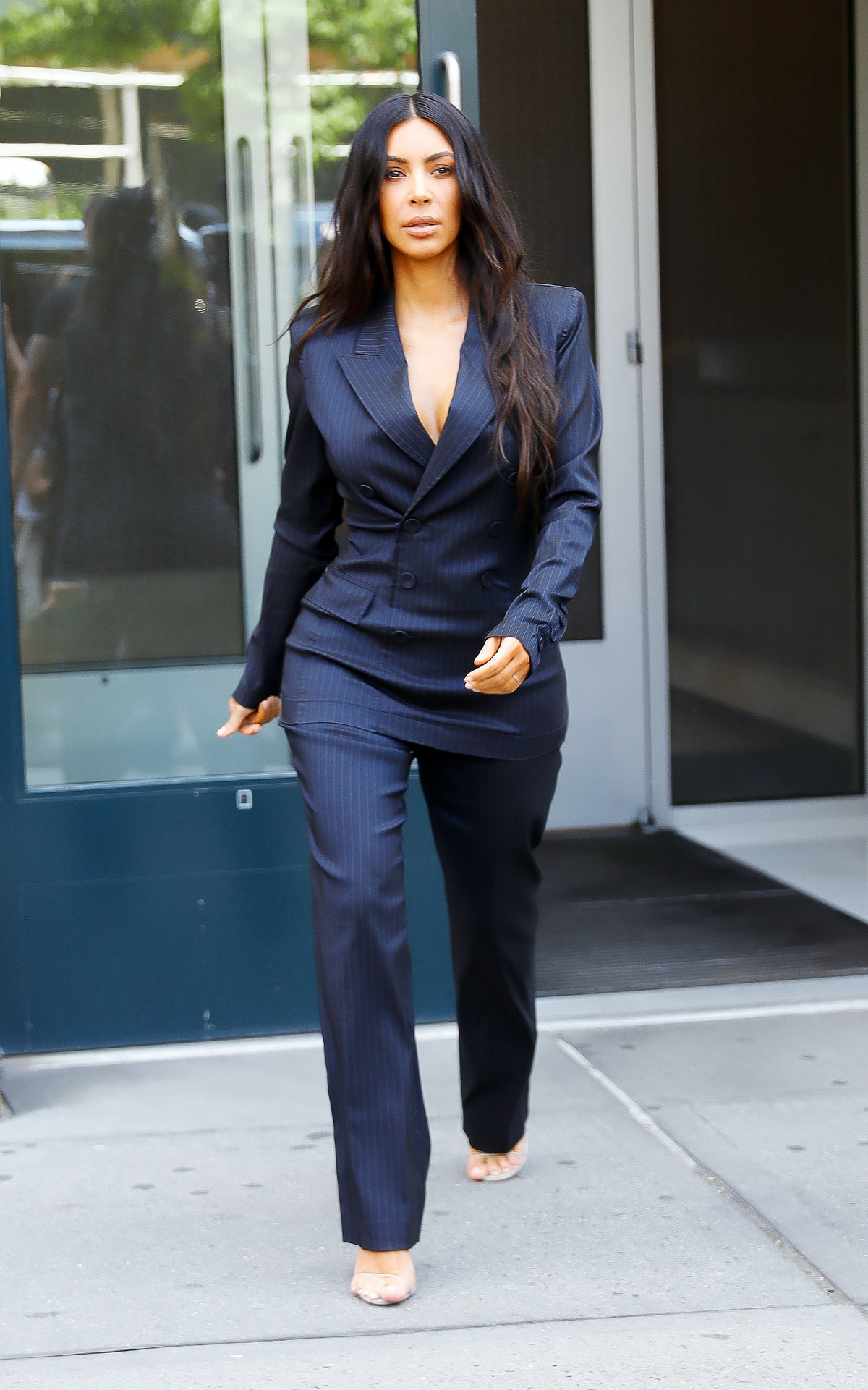NEW YORK, NY - JUNE 13: Kim Kardashian wears a blue pinstripe power-suit to attend the Forbes Women'sSummit on June 13, 2017 in New York City. (Photo by Gotham/GC Images)