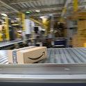 12 May 2021, Saxony-Anhalt, Sülzetal: A conveyor system transports a package at the Amazon logistics...