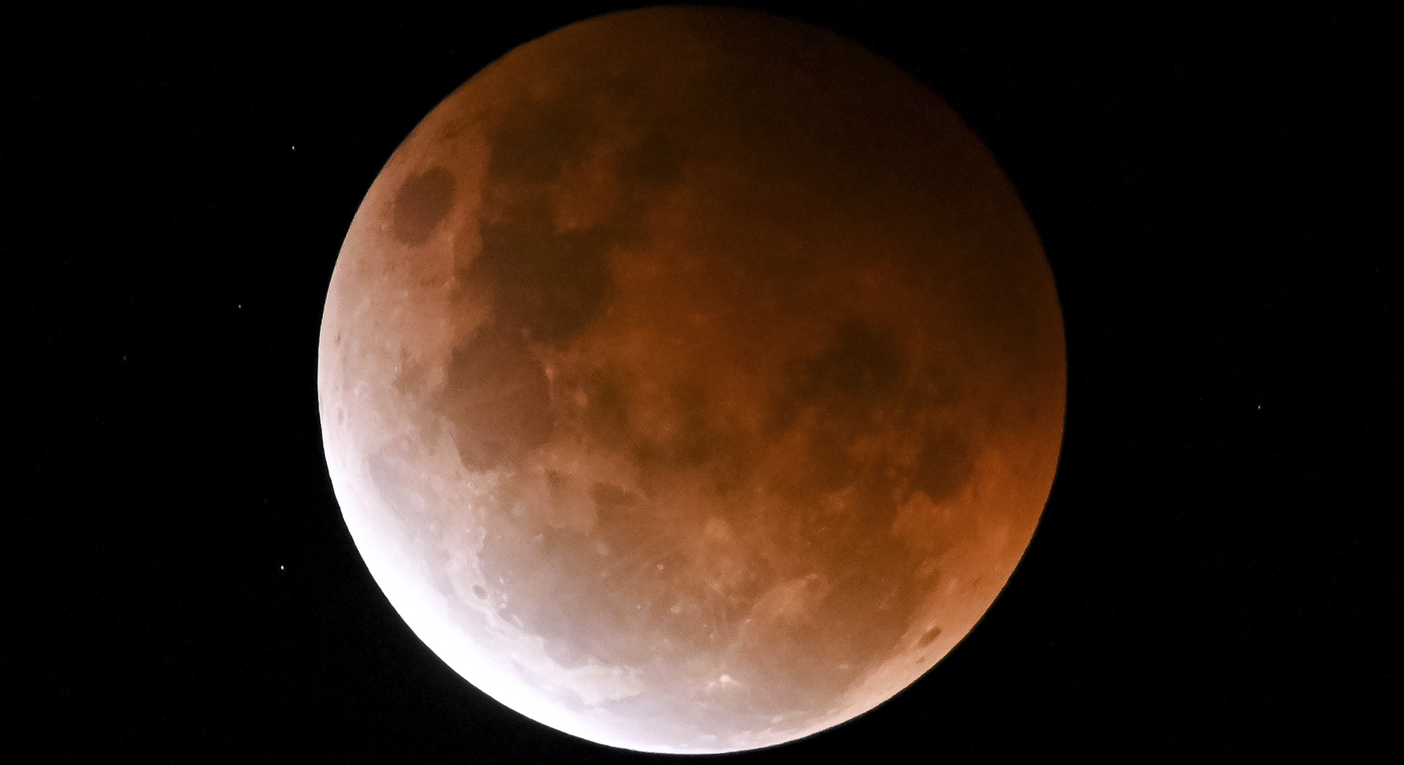 SYDNEY, AUSTRALIA - MAY 26: The full moon, known as a âsuper flower blood moonâ, is seen during its maximum lunar eclipse phase, in Sydney, Australia, on May 26, 2021. The full moon on Wednesday will be the year's biggest âsuper moonâ and feature the first total lunar eclipse in more than two years, known as a âsuper blood moonâ. A âsuper blood moonâ is when a total lunar eclipse (or âblood moonâ) happens at the same time as a âsuper moonâ, when the moon will be at perigee, or the closest point to Earth in its orbit, making it appear about 7% larger than normal and 15% brighter. The eclipse will be visible from Australia, New Zealand, the Pacific, South-East Asia and parts of North and South America at the same time. (Photo by Steven Saphore/Anadolu Agency via Getty Images)