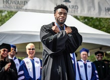 WASHINGTON, DC - MAY 12: Actor Chadwick Boseman gives a Wakanda salute to the crowd as Howard Univer...