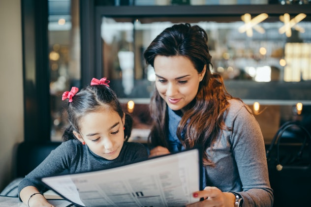 Reading the menu together is one restaurant tip from parents for picky eaters.