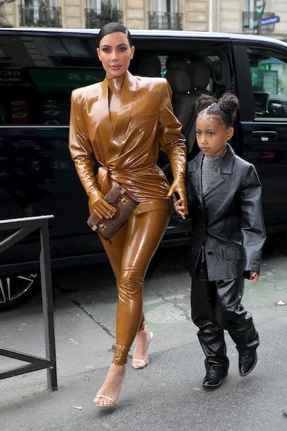 PARIS, FRANCE - MARCH 01: Kim Kardashian and her daughter North West arrive at Theatre des Bouffes d...