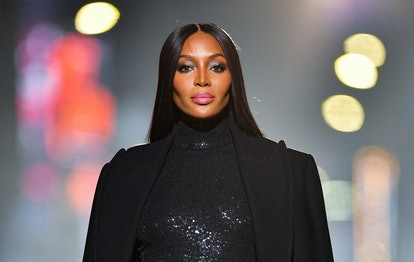 Naomi Campbell shows true celebrity Gemini energy while walking in Michael Kors Fashion Show.