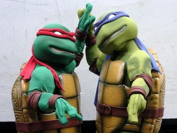 Teenage Mutant Ninja Turtles Raphael, left, and Michelangelo launch the new film, TMNT: The Movie, i...
