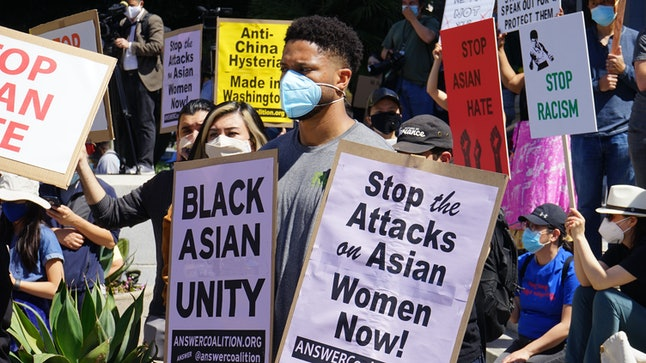 LOS ANGELES, March 27, 2021 -- People participate in a Stop Asian Hate rally and march in response to the rising violence against Asian American communities at Los Angeles City Hall, California, the United States March 27, 2021. (Photo by Zeng Hui/Xinhua via Getty) (Xinhua/xinhua via Getty Images)