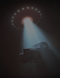 Conceptual illustration of alien abduction. Unidentified flying object (UFO) lifting a car.