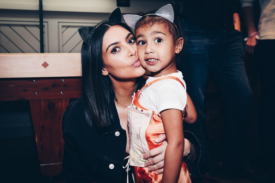 INGLEWOOD, CA - MARCH 31:  In this handout photo provided by Forum Photos,  Among the VIP guests of Managing Partner, Shelli Azoff, and Ariana Grande's manager, Scooter Braun, in the exclusive Forum Club enjoying the Ariana Grande Dangerous Woman show at the Forum were Kim Kardashian and daughter, North West on March 31, 2017 in Inglewood, California.  (Photo by Rich Fury/Forum Photos via Getty Images)