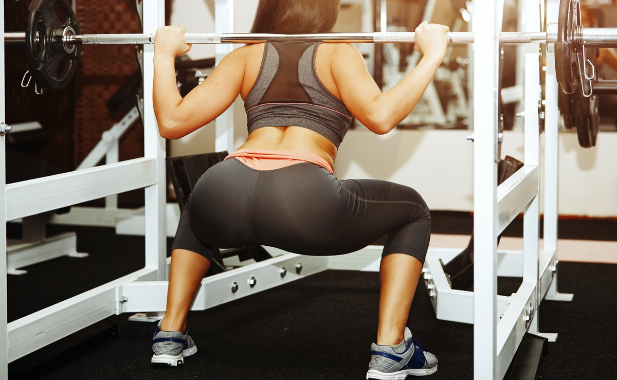 A woman does butt exercises in the gym