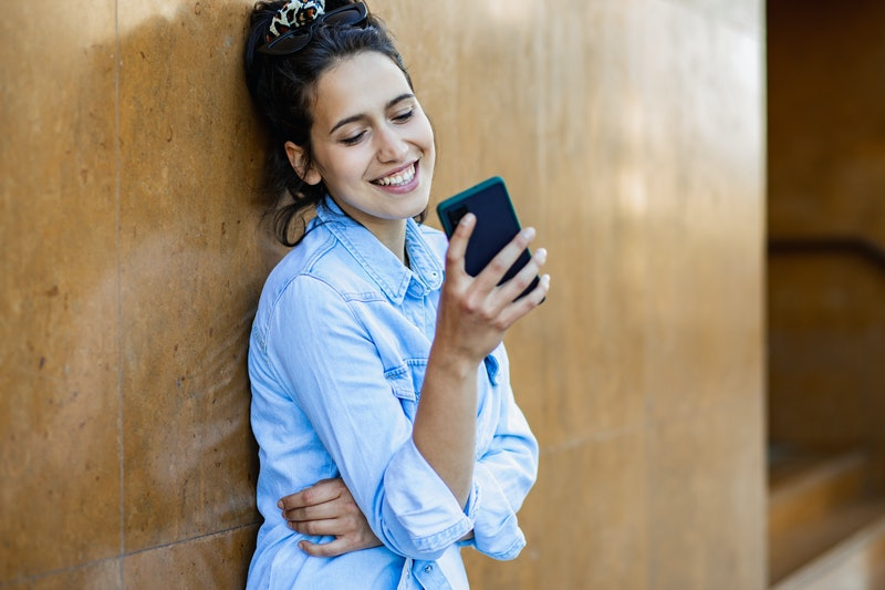 Portrait of young woman with smart phone