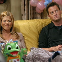 """Jennifer Aniston and Matthew Perry in between takes on the set of """"Friends"""" in 2003."""