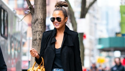 Chrissy Teigen wears FRAME jeans while out and about in NYC on February 20, 2020. The brand now host...
