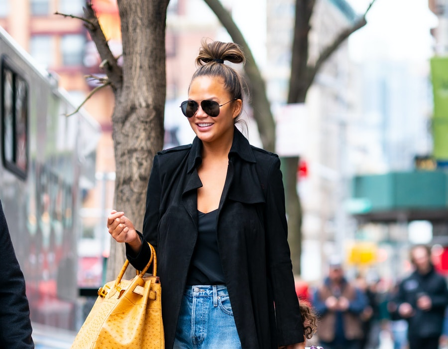 Chrissy Teigen wears FRAME jeans while out and about in NYC on February 20, 2020. The brand now hosting a major Memorial Day Sale with markdowns accross all categories.