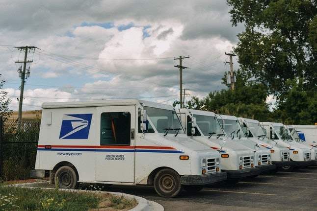 USPS truck parked in line