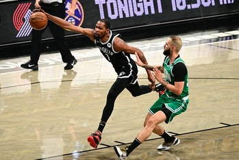 NEW YORK, NEW YORK - MAY 22:  Kevin Durant #7 of the Brooklyn Nets chases down a loose ball against Evan Fournier #94 of the Boston Celtics in Game One of the First Round of the 2021 NBA Playoffs at Barclays Center at Barclays Center on May 22, 2021 in New York City. NOTE TO USER: User expressly acknowledges and agrees that, by downloading and or using this photograph, User is consenting to the terms and conditions of the Getty Images License Agreement.  (Photo by Steven Ryan/Getty Images)