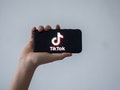 A picture taken on January 21, 2021 in Nantes, western France shows a smartphone with the logo of Ch...