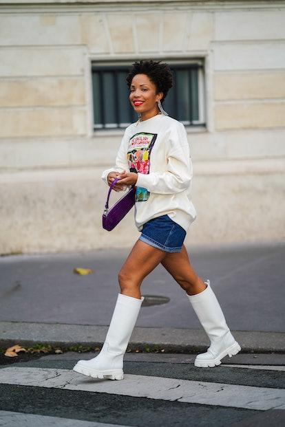 Ellie Delphine wears denim shorts and Ganni boots