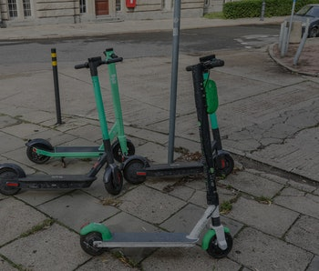 Bolt and Lime electric kick scooters standing at the pavement are  seen in Gdansk, Poland on 5 Septe...