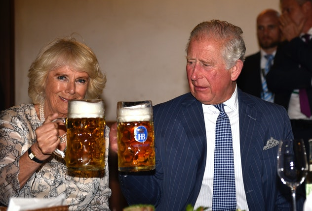 Camilla Parker Bowles and Prince Charles drink beer together.