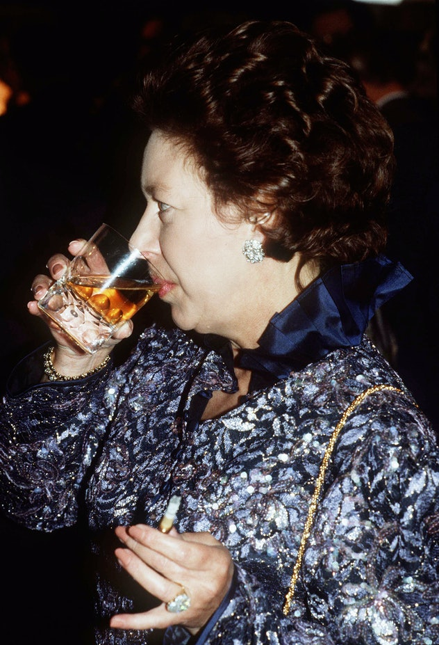 Princess Margaret enjoying a cocktail.