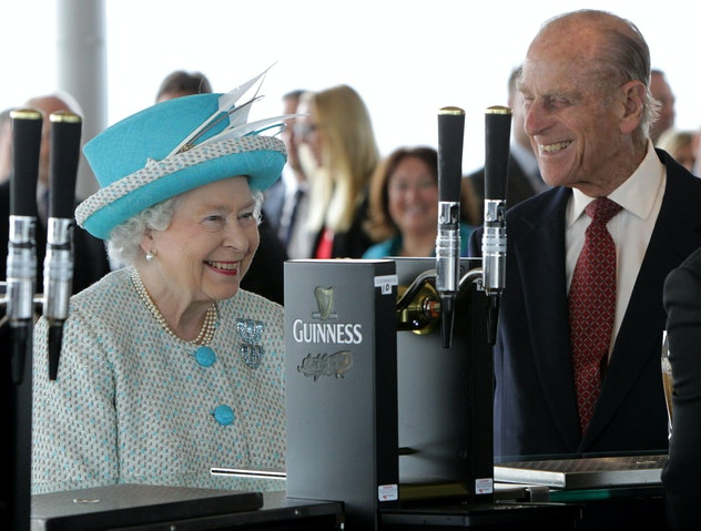 Queen Elizabeth and Prince Philip are all smiles waiting for their Guinness.