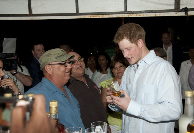 Prince Harry enjoys a local drink in Belize.