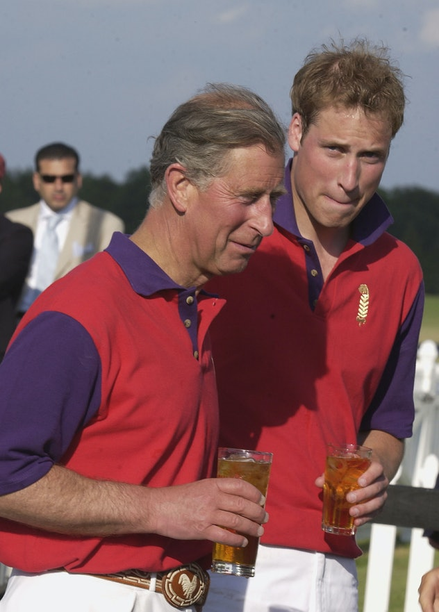 Prince William drinks with Prince Charles.